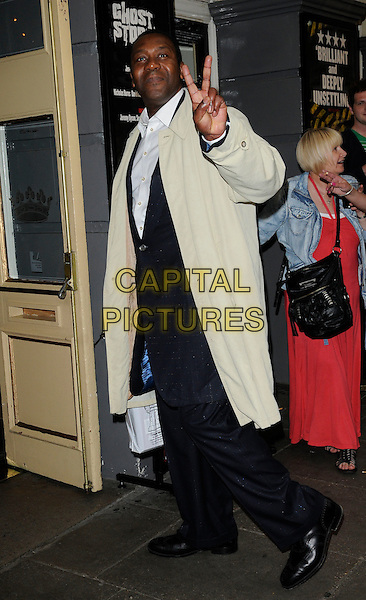 "LENNY HENRY.The ""Ghost Stories"" VIP evening, Duke of York's Theatre, London, England..July 14th, 2010.full length black suit blue navy beige trenchcoat trench coat side hand v peace sign .CAP/CAN.©Can Nguyen/Capital Pictures."