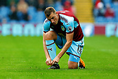 10th September 2017, Turf Moor, Burnley, England; EPL Premier League football, Burnley versus Crystal Palace; Chris Wood of Burnley ties up his boots after scoring the winning goal
