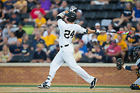 Gavin Sheets (24) of the Wake Forest Demon Deacons follows through on his swing against the West Virginia Mountaineers in Game Four of the Winston-Salem Regional in the 2017 College World Series at David F. Couch Ballpark on June 3, 2017 in Winston-Salem, North Carolina.  The Demon Deacons walked-off the Mountaineers 4-3.  (Brian Westerholt/Four Seam Images)