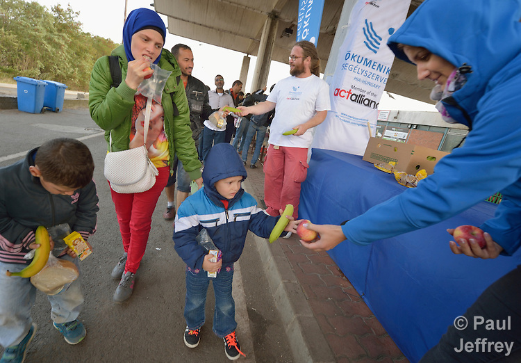 A small refugee receives food from the ACT Alliance at the border crossing into Austria near the Hungarian town of Hegyeshalom. Hundreds of thousands of refugees and migrants--including many children--flowed through Hungary in 2015, on their way to western Europe from Syria, Iraq and other countries. The ACT Alliance has provided food and other critical support for refugee and migrant families here and in other places along their journey.