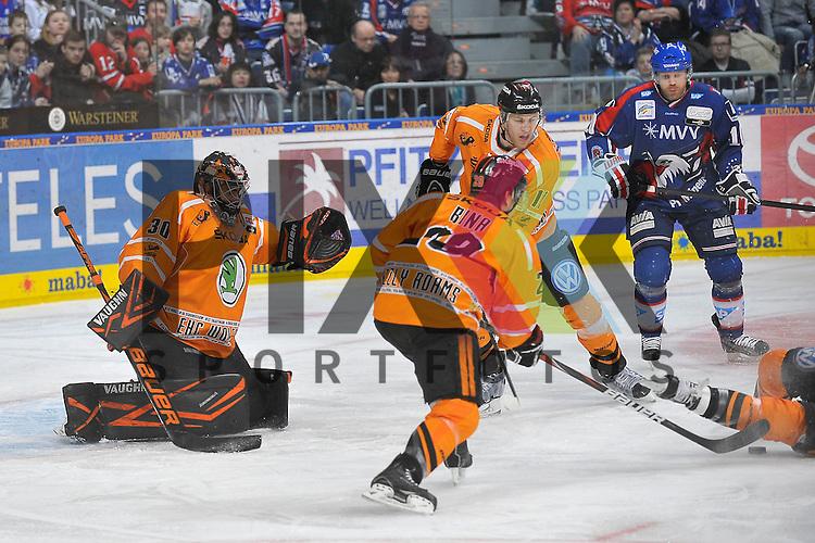 Mannheims Craig MacDonald (Nr.10) gegen Wolfsburgs Robbie Bina (Nr.28), Wolfsburgs Benedikt Schopper (Nr.11) und Wolfsburgs Daniar Dshunussow (Nr.30) beim Spiel in den Playoff der DEL, Adler Mannheim - Grizzly Adams Wolfsburg.<br /> <br /> Foto &copy; Ice-Hockey-Picture-24 *** Foto ist honorarpflichtig! *** Auf Anfrage in hoeherer Qualitaet/Aufloesung. Belegexemplar erbeten. Veroeffentlichung ausschliesslich fuer journalistisch-publizistische Zwecke. For editorial use only.