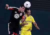 WASHINGTON, DC - AUGUST 4, 2012:  Chris Pontius (13) of DC United goes for a header against Aaron Horton (27) of the Columbus Crew during an MLS match at RFK Stadium in Washington DC on August 4. United won 1-0.