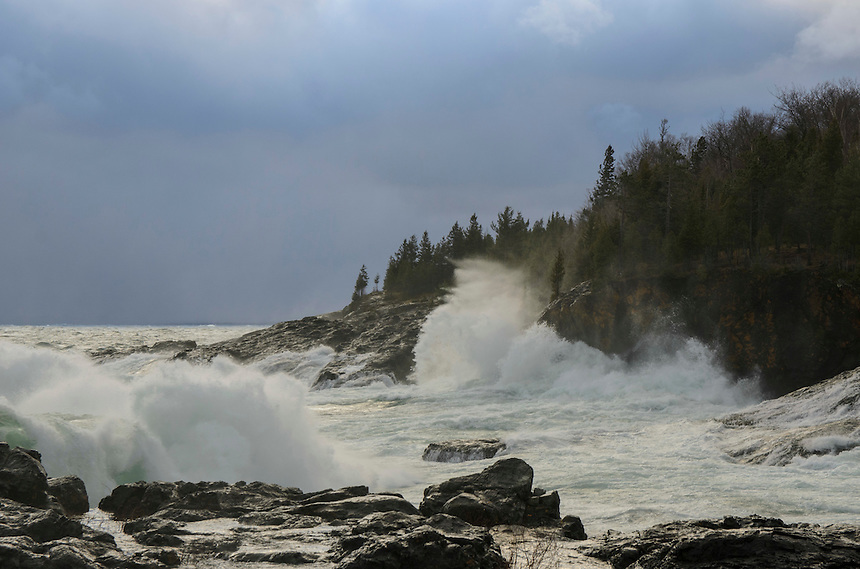 Strong wind, waves and snow along the Lake Superior shoreline at the Black Rocks. Marquette, MI