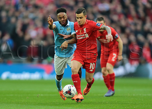 28.02.2016. Wembley Stadium, London, England. Capital One Cup Final. Manchester City versus Liverpool. Liverpool Midfielder Philippe Coutinho gets past Manchester City Midfielder Raheem Sterling during a tackle