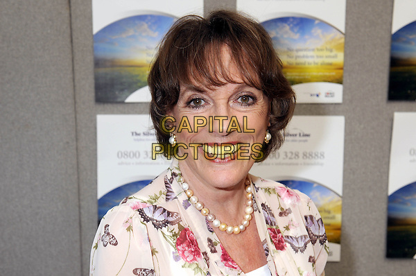 Esther Rantzen on the Silver Line Stand <br /> at The 50+ Show, Olympia, Kensington, London, UK, <br /> 12th July 2013.<br /> portrait headshot smiling pearl necklace butterfly floral print <br /> CAP//PP/BK<br /> &copy;Bob Kent/PP/Capital Pictures