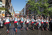 London, UK. 10 May 2014. Pictured: Chester City Morris Men dancing in Gerrard Street/Chinatown. Morris Dance groups from all over England gathered in London and performed for the public during the Westminster Morris Men Day of Dance.
