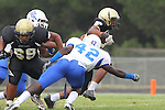 Palos Verdes, CA 09/16/11 - Joey Augello (Peninsula #58), Khalil Pettway (Culver City #42) and Okuoma Idah (Peninsula #24) in action during the Culver City-Peninsula varsity football game.