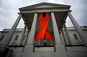 A giant red ribbon hangs on the North Portico of the White House for tomorrow's World Aids Day, Tuesday, November 30, 2010 in the  in Washington, DC. World Aids Day, observed December 1 each year, is dedicated to raising awareness of the AIDS pandemic caused by the spread of HIV infection..Credit: Olivier Douliery / Pool via CNP