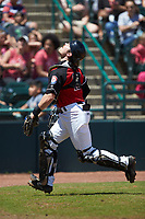 Hickory Crawdads catcher Matt Whatley (19) tracks a pop fly during the game against the Hickory Crawdads at L.P. Frans Stadium on May 13, 2019 in Hickory, North Carolina. The Crawdads defeated the RiverDogs 7-5. (Brian Westerholt/Four Seam Images)