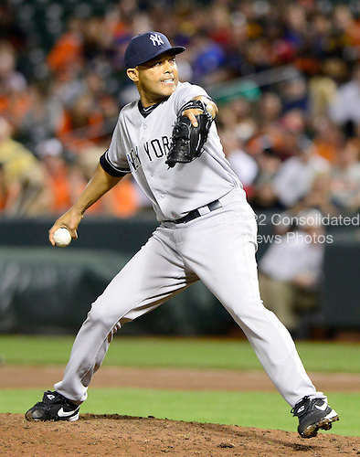 New York Yankees pitcher Mariano Rivera (42) pitches in the tenth inning against the Baltimore Orioles at Oriole Park at Camden Yards in Baltimore, Maryland on Monday, May 20, 2013.  Rivera earned the save as the Yankees won the game 6 - 4..Credit: Ron Sachs / CNP.(RESTRICTION: NO New York or New Jersey Newspapers or newspapers within a 75 mile radius of New York City)
