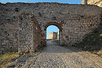 Wall and archway which form the outer entrance of Berat Castle or Kalaja e Beratit, in Berat, South-Central Albania, capital of the District of Berat and the County of Berat. The castle dates mainly from the 13th century and contains Byzantine churches, Ottoman mosques and housing. It is built on a rocky hill on the left bank of the river Osum. Picture by Manuel Cohen