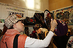 Checking out hat in mirror - Days of Our Lives' Louise Sorel stops by Jane Elissa' Hats for Health (promoting awareness and to raise money for Leukemia/Lymphoma cancer research and patient aid) booth at the Grand Central's Vanderbilt Hall Holiday Fair on December 24, 2010 in New York City, New York. There are 76 vendors with the fair running from Thanksgiving to Dec. 24. (Photo by Sue Coflin/Max Photos)