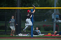 Salem-Keizer Volcanoes right fielder Dalton Combs (31) robs a home run during a Northwest League game against the Hillsboro Hops at Ron Tonkin Field on September 1, 2018 in Hillsboro, Oregon. The Salem-Keizer Volcanoes defeated the Hillsboro Hops by a score of 3-1. (Zachary Lucy/Four Seam Images)