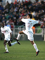 Maryland's Graham Zusi (21) celebrates after scoring the game's first goal at 43:15. The University of Maryland Terrapins defeated the Southern Methodist University Mustangs 4-1 in a Men's College Cup Semifinal at SAS Stadium in Cary, NC, Friday, December 9, 2005.