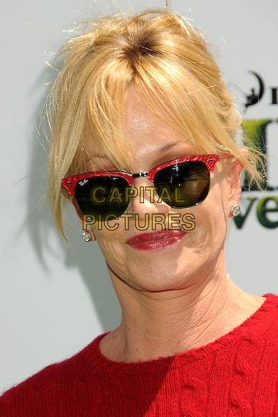 "MELANIE GRIFFITH .Attending the ""Shrek Forever After"" Los Angeles Film Premiere held at the Gibson Amphitheatre, Universal City, California, USA, 16th May 2010..arrivals portrait headshot red jumper cable knit sweater ray bans sunglasses wayfarers fringe hair up make-up lipstick .CAP/ADM/BP.©Byron Purvis/AdMedia/Capital Pictures."