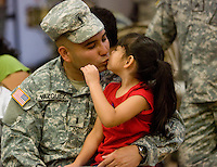 deployment0724 159900--  First Lt. Fred Vazquez, of Gilbert, kisses his daughter Felicity Vazquez before he deployed Thursday with the Phoenix-based 3666th Support Maintenance Company. The Arizona troops will head to Camp Atterbury, Ind., for 30-45 days of training and.then travel to Iraq.  (Pat Shannahan/ The Arizona Republic)