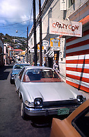Cars in narrow street in Charlotte Amalie.Series of images from St Thomas between 1975 -1977,USA.