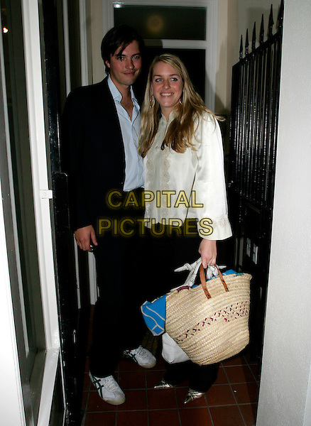 LAURA PARKER BOWLES.Eleven - gallery launch party at 11 Eccleston Street, London, SW1..October 5th, 2005.Ref: AH.full length straw bag purse white jacket.www.capitalpictures.com.sales@capitalpictures.com.© Capital Pictures.