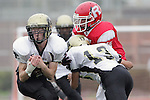Redondo Beach, CA 10/14/10 - Emmett Monahan (Peninsula #55) and Lorenzo Nunziati (Peninsula #13) in action during the Peninsula vs Redondo Junior Varsity football game at Redondo Union HIgh School.