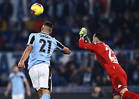 11th January 2020; Stadio Olympico, Rome, Italy; Serie A Football, Lazio versus Napoli; Lazio's serbian midfielder Sergej Milinkovic-Savic  sees the ball punched away from danger by Ospina of Napoli - Editorial Use
