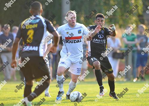 2013-07-06 / voetbal / seizoen 2013-2014 / Westerlo - Lokeren / Birger Maertens (m) (Westerlo) in duel met Dutra Sergio Junior (l) (Lokeren)