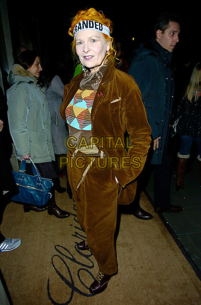 VIVIENNE WESTWOOD.At the Marc by Marc Jacobs a/w 2007/8 catwalk show,.Claridge's, London, England, February 16th 2007..full length head band slogan logo Branded brown suit trousers jacket boots.CAP/CAN.©Can Nguyen/Capital Pictures