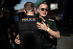 © Joel Goodman - 07973 332324 - all rights reserved . 24/08/2019. Manchester, UK. Policeman and Paramedic hug . The 2019 Manchester Gay Pride parade through the city centre , with a Space and Science Fiction theme . Manchester's Gay Pride festival , which is the largest of its type in Europe , celebrates LGBTQ+ life . Photo credit: Joel Goodman/LNP