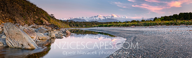 Sunset over Mt. Cook 3754m right and Mt. Tasman 3497m left from Gillespies Beach, Westland NP, West Coast, World Heritage Area, South Westland, New Zealand