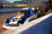 Nov 12, 2010; Pomona, CA, USA; NHRA funny car driver Tim Wilkerson on fire after an explosion during qualifying for the Auto Club Finals at Auto Club Raceway at Pomona. Mandatory Credit: Mark J. Rebilas-