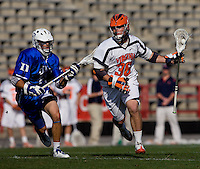Brian Carroll (36) of Virginia carries the ball past Jake Tripucka (27) of Duke during the ACC men's lacrosse tournament semifinals in College Park, MD.  Virginia defeated Duke, 16-12.