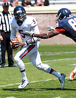 Virginia quarterback David Watford (5) gets pressured by Virginia defensive end Max Valles (88) during the annual Virginia football Orange-Blue Spring Game Saturday at Scott Stadium in Charlottesville, VA. Photo/The Daily Progress/Andrew Shurtleff