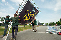 NWA Democrat-Gazette/BEN GOFF @NWABENGOFF<br /> Staff from Bentonville Parks and Recreation assemble the finish line structure and a photo backdrop Friday, June 8, 2018, for the Memorial Park Glow Run. The two-mile run starting at 8:45 p.m. kicks off the Bentonville Parks and Recreation 2018-19 Run Bentonville Race Series. Participants receiver glow-in-the-dark race shirts, Energizer headlamps and other 'glow gear' for the after dark race.