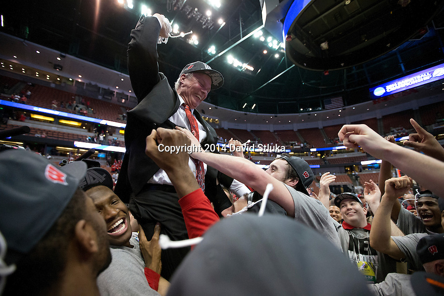 Wisconsin Badgers teammates hoist up Head Coach Bo Ryan during  the Western Regional Final NCAA college basketball tournament game against the Arizona Wildcats Saturday, March 29, 2014 in Anaheim, California. The Badgers won 64-63 (OT). (Photo by David Stluka)