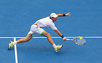 Blaz Kavcic of Slovenia hits a backhand to Bernard Tomic of Australia during their men's singles match at the Sydney International tennis tournament, Jan. 8, 2014.  IMAGE RESTRICTED TO EDITORIAL USE ONLY. Photo by Daniel Munoz/VIEWpress