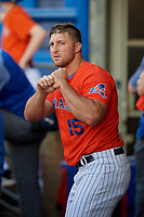 Syracuse Mets Tim Tebow (15) in the dugout during an International League game against the Charlotte Knights on June 11, 2019 at NBT Bank Stadium in Syracuse, New York.  Syracuse defeated Charlotte 15-8.  (Mike Janes/Four Seam Images)
