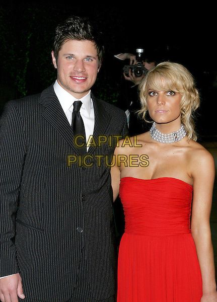 NICK LACHEY & JESSICA SIMPSON.2005 Vanity Fair Oscar Party held at Morton's Restaurant. West Hollywood, CA.February 27th, 2005.Photo Credit: Jacqui Wong/AdMedia.half length strapless red dress pearl choker married celebrity couple husband wife pinstripe black suit.www.capitalpictures.com.sales@capitalpictures.com.© Capital Pictures.