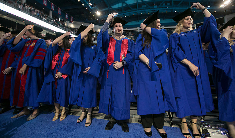 Driehaus College of Business graduates turn their tassels following their commencement ceremony, Sunday, June 10, 2018, at the Wintrust Arena. Approximately 6,700 DePaul University students graduated during five ceremonies held over the weekend. (DePaul University/Jamie Moncrief)