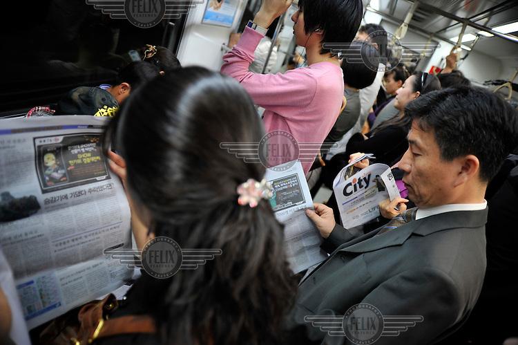 Passengers on Seoul's underground train system.