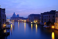 Morning breaks over the Grand Canal, viewed from Accademia Bridge, Venice, Italy