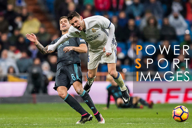 Mateo Kovacic (r) of Real Madrid gets tripped up by Inigo Martinez Berridi of Real Sociedad during their La Liga match between Real Madrid and Real Sociedad at the Santiago Bernabeu Stadium on 29 January 2017 in Madrid, Spain. Photo by Diego Gonzalez Souto / Power Sport Images