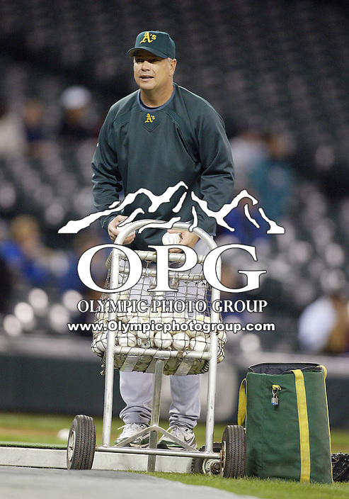 29 September 2009: Oakland A's pitching coach Curt Young tossed pre game batting practice before the game against the Seattle Mariners. Seattle won 6-4 over the Oakland A's at Safeco Field in Seattle, Washington.