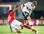 (L) Paulinho of Guangzhou Evergrande competes for the ball with (R) Thomas Muller of Bayern Munich during the Bayern Munich vs Guangzhou Evergrande as part of the Bayern Munich Asian Tour 2015  at the Tianhe Sport Centre on 23 July 2015 in Guangzhou, China. Photo by Aitor Alcalde / Power Sport Images