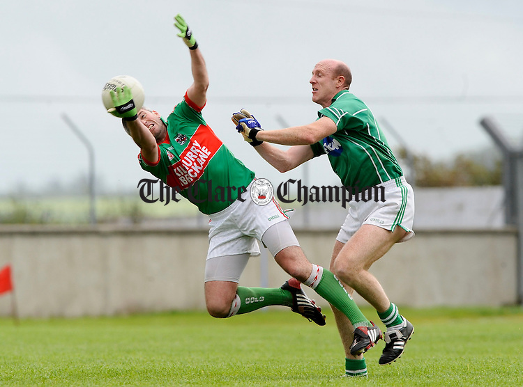 Johnny Daly of Kilmurry Ibrickane is sent flying by Kilrush's Donal O Sullivan during their championship game at Cooraclare. Photograph by John Kelly.
