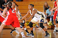 28 January 2012:  FIU guard Kamika Idom (14) defends WKU guard Chaney Means (2) in the second half as the FIU Golden Panthers defeated the Western Kentucky University Hilltoppers, 60-56, at the U.S. Century Bank Arena in Miami, Florida.