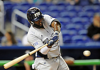 Florida International University outfielder Pablo Bermudez (12) plays against the Miami Marlins, which won the game 5-1 on March 7, 2012 at Miami, Florida. .