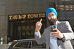 King Singh of Manhattan, New York takes a selfie in front of Trump Towers on December 21, 2016.