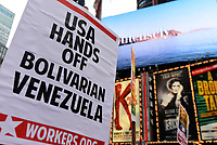 "NEW YORK, USA - JUNE 06: Pro Chavez- Maduro activists attend the march ""Hands Off Venezuela!"" organize by the The International Action Center in  Solidarity whit Bolivarian Venezuela in Times Square on June 6, 2017 in New York. Joana Toro/VIEW press"