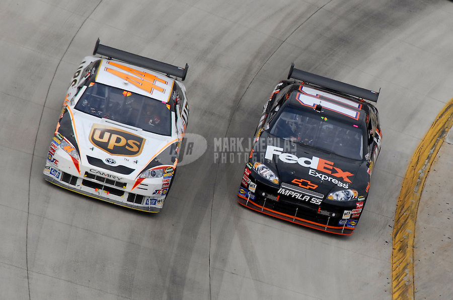 Apr 1, 2007; Martinsville, VA, USA; Nascar Nextel Cup Series driver Denny Hamlin (11) races alongside Dale Jarrett (44) during the Goody's Cool Orange 500 at Martinsville Speedway. Martinsville marks the second race for the new car of tomorrow. Mandatory Credit: Mark J. Rebilas