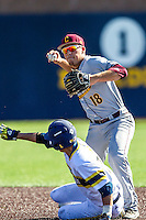 Central Michigan Chippewas second baseman Jason Sullivan (18) turns a double play against the Michigan Wolverines on March 29, 2016 at Ray Fisher Stadium in Ann Arbor, Michigan. Michigan defeated Central Michigan 9-7. (Andrew Woolley/Four Seam Images)