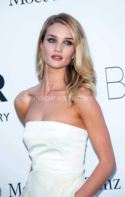 WWW.ACEPIXS.COM....US Sales Only....May 23 2013, New York City....Rosie Huntington-Whiteley at amfAR's Cinema Against AIDS Gala at the Hotel du Cap Eden Roc during the Cannes Film Festival on May 23 2013 in France....By Line: Famous/ACE Pictures......ACE Pictures, Inc...tel: 646 769 0430..Email: info@acepixs.com..www.acepixs.com